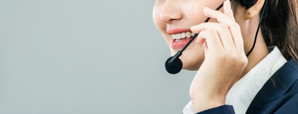 Female call center talking with customer at desk